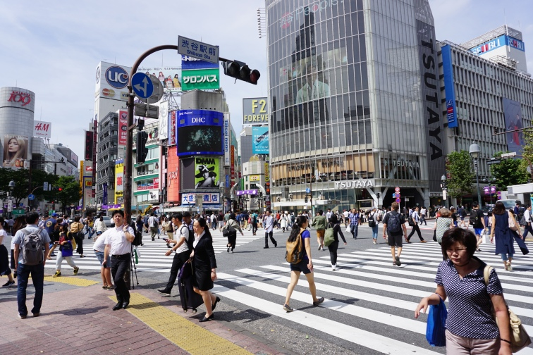 People crossing the intersection at the Shibuya Scramble
