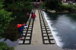 Stone footbridge over the river